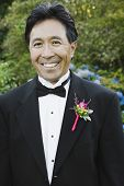 Asian man with boutonniere on lapel