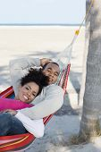 Hispanic couple laying in hammock