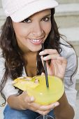 Hispanic woman drinking cocktail
