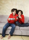 picture of identical twin girls  - African twin sisters playing video games - JPG