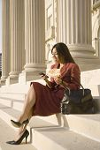 Indian businesswoman eating on steps