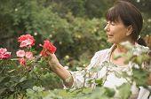Senior Hispanic woman looking at rose