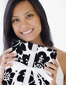 Pacific Islander woman holding gift