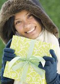 stock photo of pacific islander ethnicity  - Pacific Islander woman holding gift - JPG