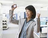 Asian businesswoman cheering