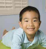 Asian boy laying on table