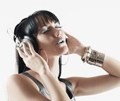 Pacific Islander woman listening to headphones