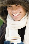 Pacific Islander woman drinking hot chocolate