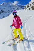 Skiing, skier on ski run - child skiing
