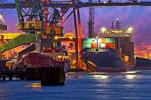 stock photo of ship  - The unloading of a container ship at a large harbor terminal - JPG