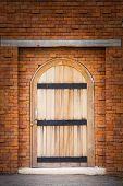 Wooden Door On Brick Wall
