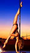 foto of pole dancer  - Young sexy pole dance woman on urban background - JPG