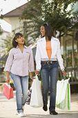 African teenaged girls carrying shopping bags