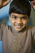 Indian boy with hands over head