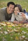 Asian couple taking own photograph