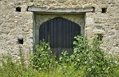 picture of tithe  - Door into St Leonards Grange medieval tithe barn New Forest - JPG