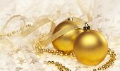 Two golden Christmas baubles