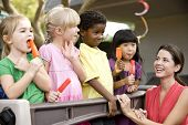 picture of daycare  - Diverse group of preschool 5 year old children playing in daycare with teacher - JPG
