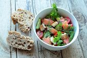 Bowl with salmon salad