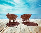 Tropical Beach With Chairs On Wooden Terrace