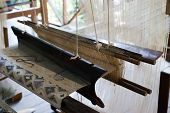 stock photo of handloom  - Vintage manual weaving loom with unfinished textile work - JPG