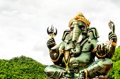 Green Ganesha Hindu God Statue Close Up On Natural Background