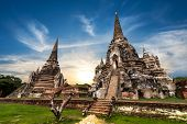 Asian Religious Architecture. Ancient Buddhist Pagoda Ruins At Wat Phra Sri Sanphet Temple Under Sun