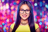 Girl wearing glasses in nightclub
