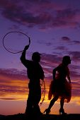 Silhouette Cowboy Rope Woman
