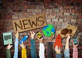 Hands Holding Symbols with News Concept