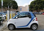 Car2go car parked at Electric Car charging station and ready to hire  at Balboa Park in San Diego