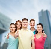 friendship, city life, business and people concept - group of smiling teenagers over city background