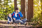 Father and son in the forest
