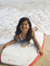 image of boogie board  - Pacific Islander girl laying on boogie board - JPG