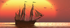 picture of sloop  - A galleon frigate ship makes it way across ocean waters as the sun sets on another day - JPG