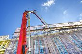 picture of chute  - Construction Tower Crane Pouring Concrete  - JPG