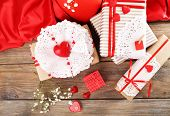 Handmade gifts on Valentine Day, on wooden background