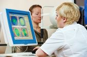 Optometry concept. female optometrist optician doctor evaluates eyesight of female patient in eye ophthalmological clinic
