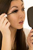 Beautiful Teen Model Applying Mascara Holding Hand Mirror