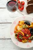 Tasty multicolor pasta with pepper, carrot and tomatoes on wooden table background