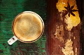 A cup of black coffee on old wooden backdrop