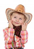 Smiling little girl in the big wide-brimmed hat.
