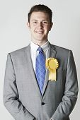 Portrait Of Politician Wearing Yellow Rosette