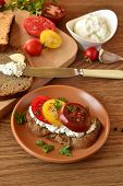 Sandwich with cream cheese tomatoes and herbs