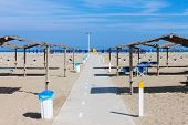 Rows Of The Palm Leaf Sun Shades On The Beach