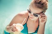 Little Girl With Cocktail And Sunglasses In Swimming Pool