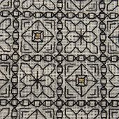 Close-up of Blackwork embroidery with gold highlights