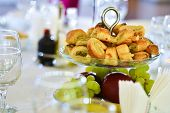 pic of phyllo dough  - Pastry with meat placed on a glass support a wedding day - JPG
