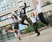 Young Business People In The Jump