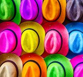 stock photo of panama hat  - Stacks of colorful hats line the sidewalks in Cartagena - JPG